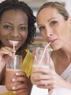 two women drinking shakes